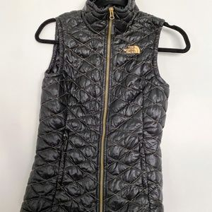 The North Face Black and Gold Puffer Vest